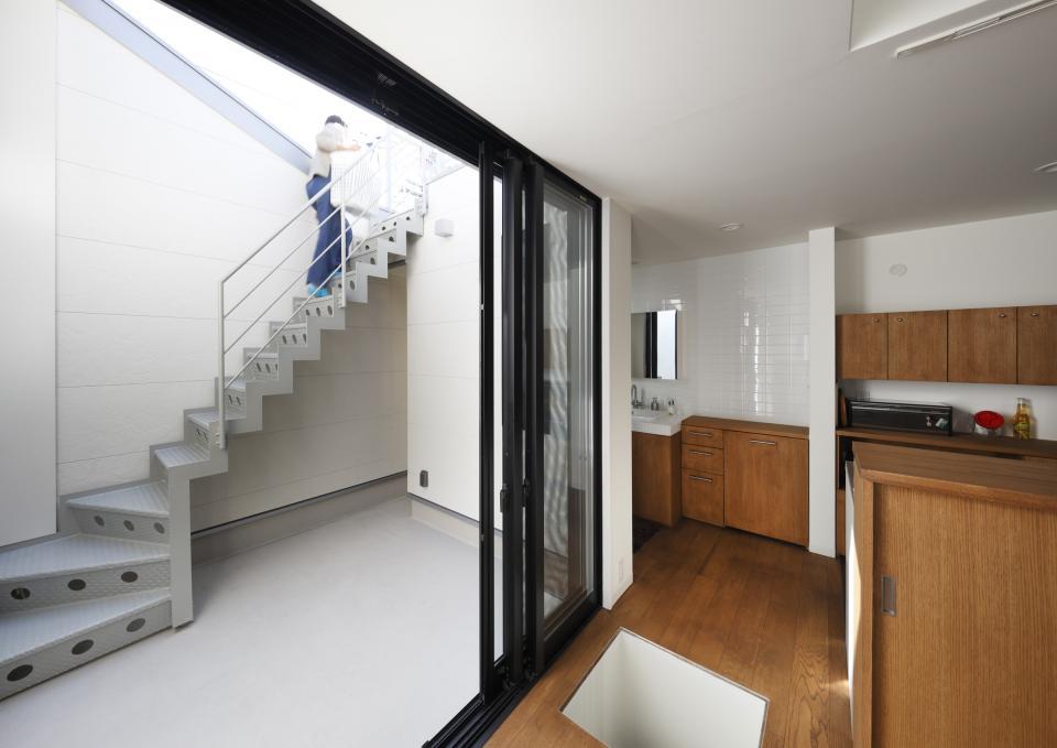 5段の距離がいい -程よい距離感の二世帯住宅 長屋のフルリノベーション-の写真3