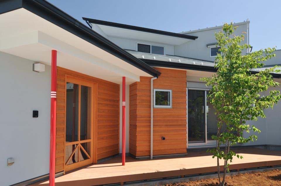 室内と庭空間 敷地を一体化する三角形プランの写真11